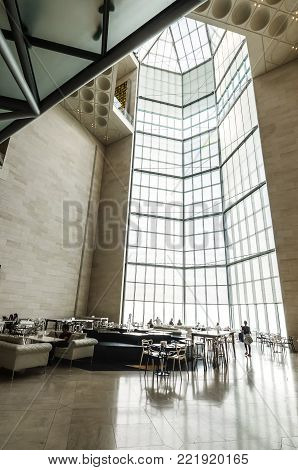 Doha city, Qatar - January 02, 2018: Huge stained-glass window in the restaurant in main hall of the popular Museum of Islamic Art in Doha city, Qatar