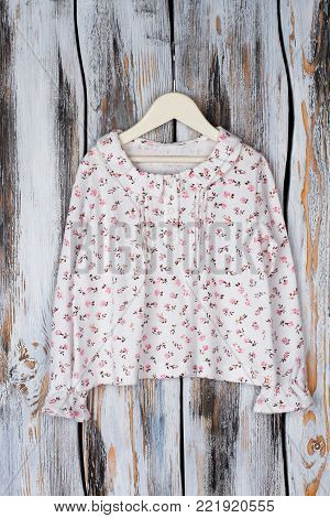 Floral top with ruffle collar and cuffs. Cute blouse, peasant style. Fashionable garment for girl's smart look.