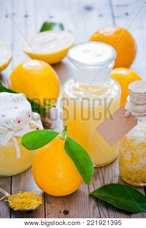 Fresh lemons, Lemon Curd, lemon with sugar and Lemon Zest