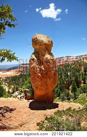 Lone hoodoo shaped like a person along Tower Bridge Trail in Bryce Canyon National Park