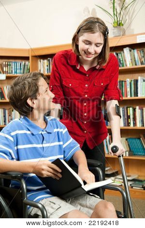 Two disabled students inthe school library.