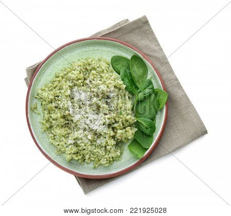 Plate with delicious spinach risotto on white background