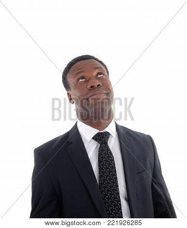 An African business man in a suit rolling his eye's up for frustration isolated for white background