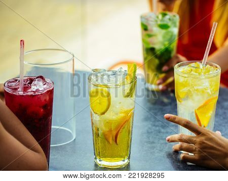 Cocktails mix with fruit for girls party in bar. Thirst and refresh. women drink cocktail with ice cube. Bar and restaurant, cocktail party. Party and summer vacation.