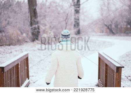Smiling Young Woman In Snowing Outdoor.
