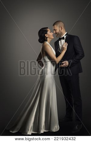 Retro Couple, Well Dressed Woman in Long White Dress and Elegant Man in Black Suit, Full Length Portrait