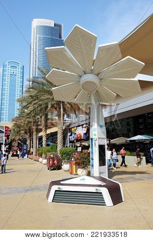 DUBAI, UAE - NOVEMBER 17: The Smart Palm is on Dubai Motor Show 2017 on November 17, 2017. It can generate around 7.2 kilowatt hours per day, allow people access Wi-Fi, and charge their phones for free