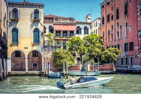 Venice, Italy - May 18, 2017: Motorboat sailing along the Grand Canal. Motor boats are the main transport in Venice.