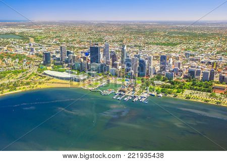 Aerial view of Perth Skyline in Australia. Scenic flight over Elizabeth Quay, Bell Tower, Elizabeth Quay Bridge, Swan River, Perth Convention and Exhibition Center in Western Australia. Copy space.