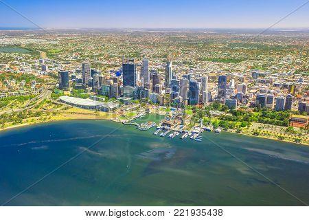 Aerial view of Perth Skyline in Australia. Scenic flight over Elizabeth Quay, Bell Tower, Elizabeth Quay Bridge, Swan River, Perth Convention and Exhibition Center in Western Australia. Copy space.