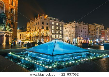 Krakow, Poland, January 22, 2017: Fountain at night on main square of Krakow city, Poland