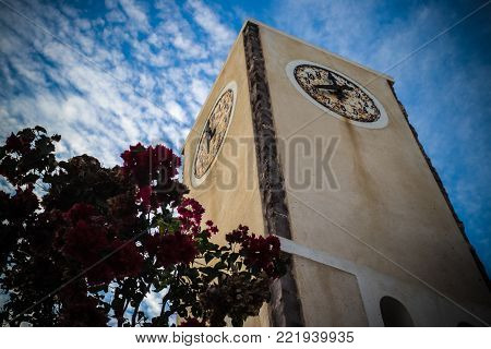 Rustic Clock tower in Oia, Santorini, Greece