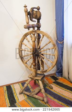 Ancient Russian wooden spinning wheel. Tradition handcraft tool