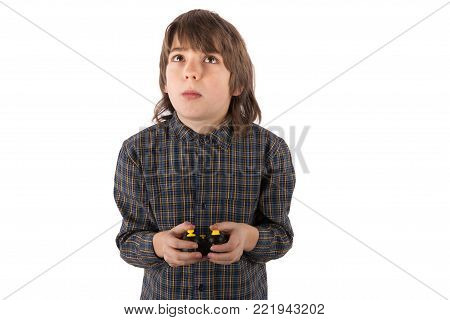 Boy Controlling A Flying Drone With A Small Radio Remote Control. Isolated On White Background.