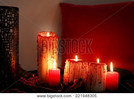 Creepy candles for Halloween on table indoors