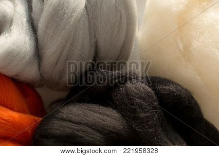 Colorful merino wool, white, black, red and gray colors, for felting, close up
