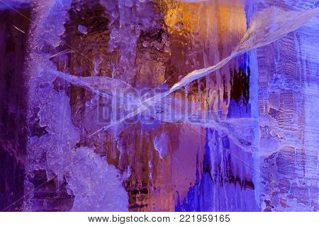 blue ice texture with a pattern and cracks background, ice frozen rink winter background, texture of ice surface, sunlit ice blocks texture, frozen water