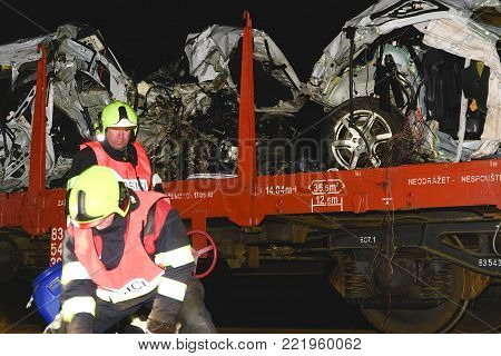 SAKVICE, THE CZECH REPUBLIC -  JANUARY 14, 2018: The crashed car is transported away. Real car crash with train. The woman driver is dead. The firefighters cleaning up the rest of crashed car.