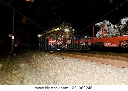 SAKVICE, THE CZECH REPUBLIC -  JANUARY 14, 2018: The crashed car is transported away. Real car crash with train. The woman driver is dead. The firefighters  finished cleaning up the railway line.