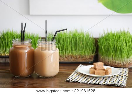 Mason jars with protein shake on counter in sport bar
