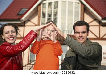 Young Family And House