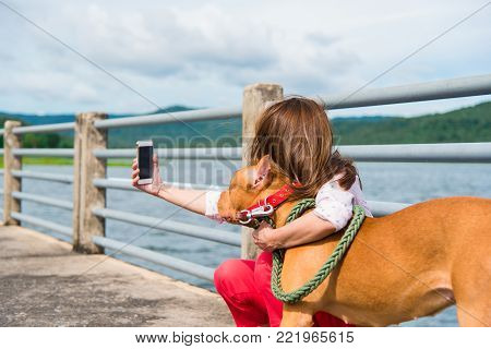 Selfie Of A Woman With Her Beautiful Dog In Park.