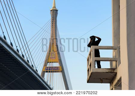 A Photographer Has Shooting Photo Of  Bhumibol Bridge With Blue Sky In The Evening At Bangkok Thaila