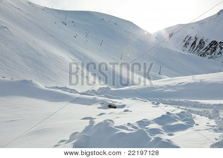 Snow Mountains And Sun Beams