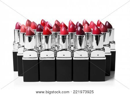 Lipsticks of different shades on white background