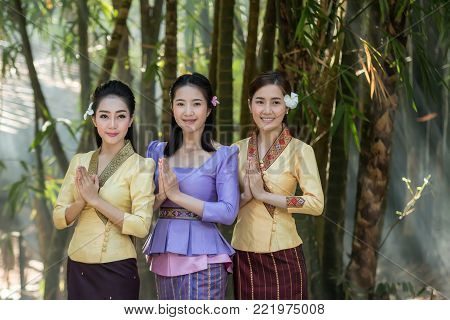 Beautiful Laos girl in Laos costume,Asian woman wearing traditional Laos culture standing at temple at countryside Laos.