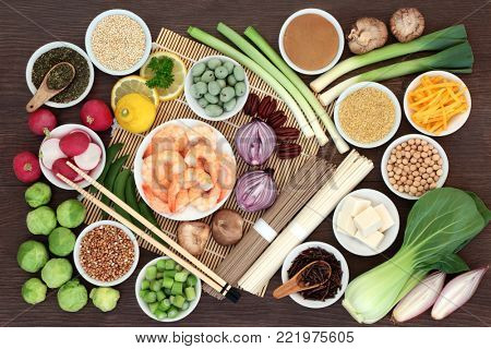 Japanese macrobiotic super food concept with tofu, soba and udon noodles, miso, wasabi nuts, kuchika tea, grains, legumes, vegetables, with foods high in protein, antioxidants and vitamins.