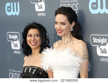 Loung Ung and Angelina Jolie at the 23rd Annual Critics' Choice Awards held at the Barker Hangar in Santa Monica, USA on January 11, 2018.