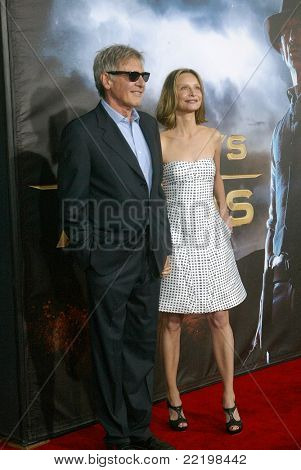 "SAN DIEGO, CA - JULY 23: Harrison Ford and Calista Flockhart arrive at the world premiere of ""Cowboys and Aliens"" on July 23, 2011 at the Civic Theatre in San Diego, CA."