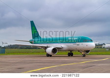 SHANNON AIRPORT, IRELAND - JULY 9, 2011: Aer lingus planes on the runway of Shannon International Airport in Ireland. Aer lingus is the flag carrier airline and the second-largest airline in Ireland.