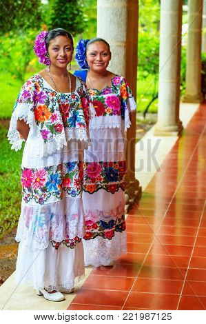 PISTE TOWN, YUCATAN, MEXICO - JULY 12, 2011: Beautiful mexican folk dancers in traditional colorful dresses. This is very popular tourist attraction on the way to Chichen Itza, Mexico.