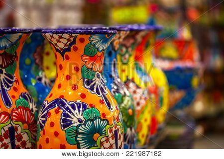 PLAYA DEL CARMEN, MEXICO - JULY 12, 2011: Local souvenirs on display at beach market in Playa Del Carmen, Mexico
