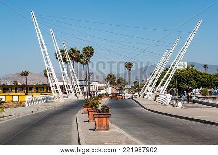 ENSENADA, MEXICO - MAY 3, 2017:  Decorative white bridge crossing the Arroyo Ensenada on Avenida Adolfo López Mateos.