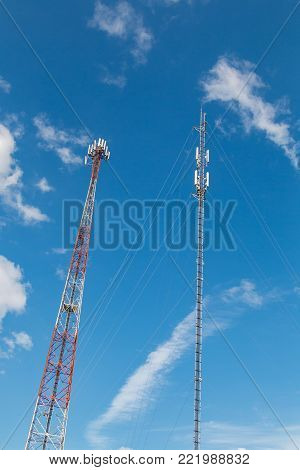 Cellular phone antennas with sky blue background.