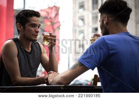 Homosexual Couple Drinking Beer in a Pub in Paulista Avenue, Sao Paulo, Brazil
