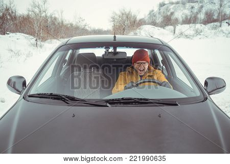 angry man pissed off in car in winter day