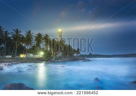 View of lighthouse Dondra and lights at night Matara, Sri Lanka