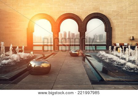 Doha city, Qatar - January 02, 2018: View at the heart of finance world of Qatar capital - Doha City thought the tree arches at the Museum of Islamic Art on the Persian Gulf., Doha, Qatar.