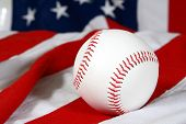 baseball on an American flag showing seams close-up poster