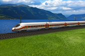 Scenery of modern high speed train passing by the mountains and flords in Norway poster
