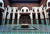 Meknes Morocco: Intricate and symetrical interior of Muslim madrasah school in Meknes Morocco. poster