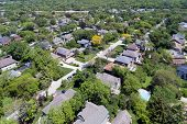 Aerial view of a neighborhood with mature trees in a Chicago suburban neighborhood in summer. Deefield, IL. USA poster