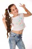 Portrait of beautiful happy brunette young teen girl in blue jeans and a bare belly. The adorable slender smiling preteen is an image of children's summer fashion. poster