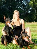 pretty women with own dobermans outdoor sunny evening poster