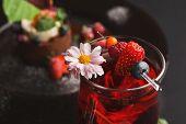 Tasty sweet background. Closeup of berry tea near exclusive restaurant mousse dessert, selective focus poster