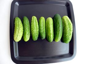 Cucumbers on the black plate